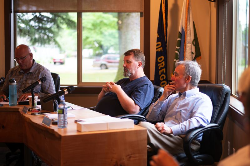 PMG PHOTO: ANNA DEL SAVIO - Commissioner Chip Bubl, right, sits with Commissioners Robert Keyser and Larry Ericksen at the July 10 Port of Columbia County commission meeting.