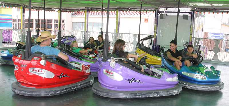 PMG PHOTO: JUSTIN MUCH - Some just came to enjoy the rides at the Marion County Fair Friday, July 12.