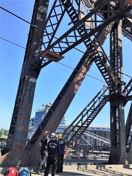 COURTESY PPB - First responders during the Sunday morning incident on the Steel Bridge.