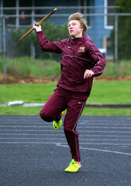 PMG PHOTO: JIM BESEDA - Milwaukie's Arthur Katahdin, pictured in an April 10 meet at La Salle Prep, posted a score of 5,676 to place fourth in the 17-18 boys decathlon at the USATF Junior Olympic Track and Field Championships in Tacoma.
