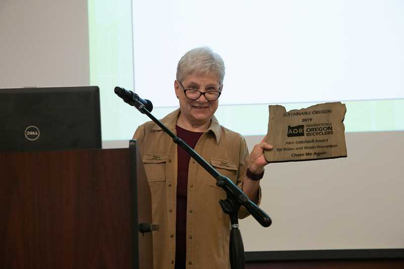 COURTESY PHOTO: ASSOCIATION OF OREGON RECYCLERS - Gresham resident and volunteer Charlotte Becker received the Recycler of the Year award on behalf of Chase Me Again.