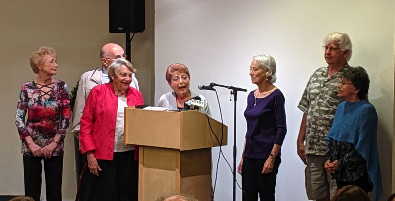 PMG: JOSEPH GALLIVAN - Eva Eigner (center) with other holocaust survivors addresses the crowd at the signing of Oregon's Holocaust Education Bill.