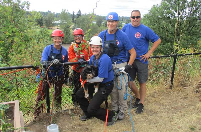 DEBORAH GUINTHER - The rescue team that hauled the lost dog out were: (from left) Nicole Broder, team leader Virginia Krakowwiak, Maddi Mattecheck, Stefan Matthaeus, and drong operator Mike Borden.
