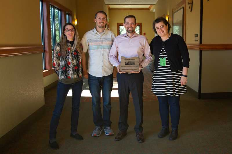COURTESY PHOTO: ASSOCIATION OF OREGON RECYCLERS - Alan Crapser, with award, posed with city of Gresham staff in celebration of being named a Recycler of the Year.
