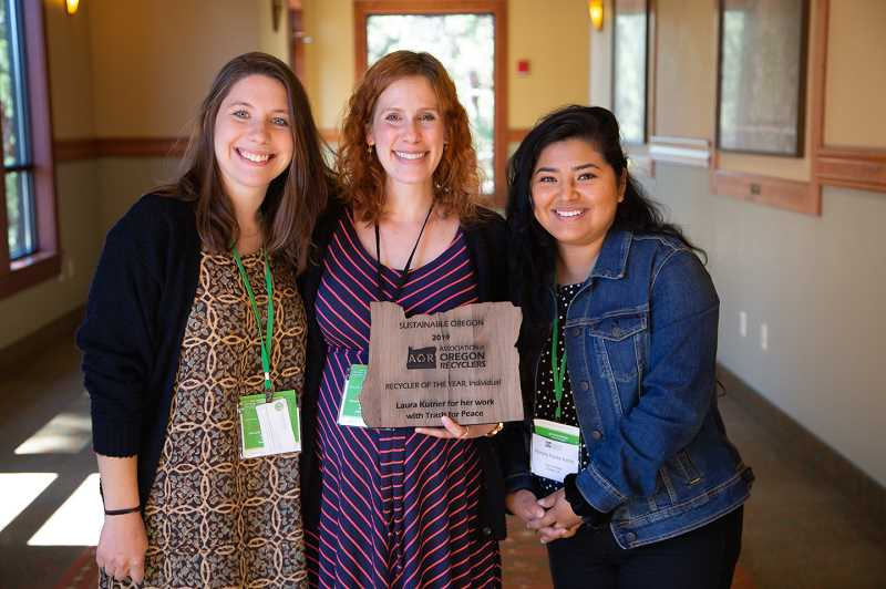 COURTESY PHOTO: ASSOCIATION OF OREGON RECYCLERS - Laura Gumpert, Laura Kutner and Alondra Flores Aying, all with Trash for Peace, show off their award from the Association of Oregon Recyclers.