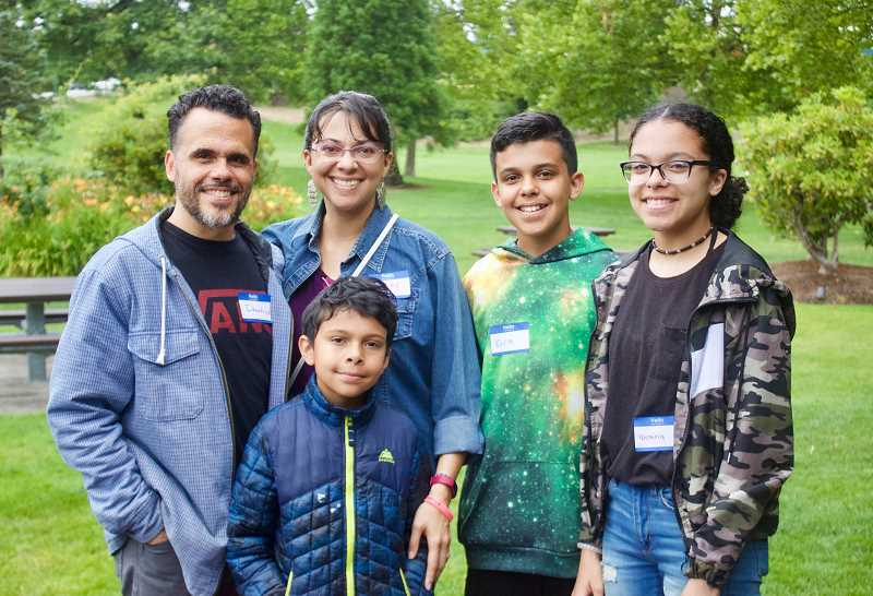 PMG PHOTO: CHRISTOPHER KEIZUR - Demetrius, Elijah, Audrey, Ezra and Victoria Rogers all knew they wanted to volunteer at the Gresham Arts Festival after moving to Gresham in 2017.