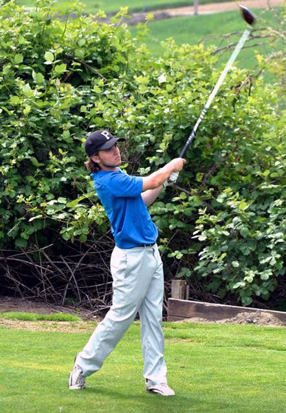 COURTESY PHOTO - Aaron Buck follows through after a tee shot during the Pacific Northwest District Optimist International qualifier at Forest Hills Golf Course in Cornelius in late May.