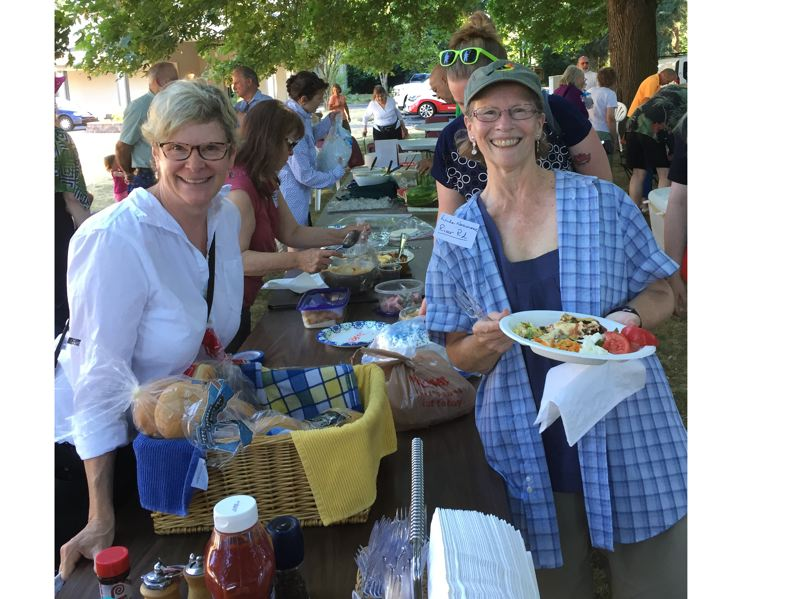 COURTESY PHOTO - Jan Lindstrom and Linda Neumann enjoy last year's picnic hosted by the Jennings Lodge Community Planning Organization, which is scheduled this year for Tuesday.