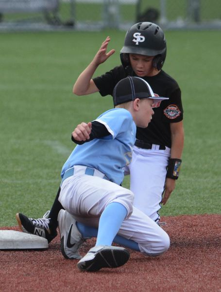 PMG PHOTO: DAVID BALL - Sandys Kobe Sparks slides in safely with a steal at second base.