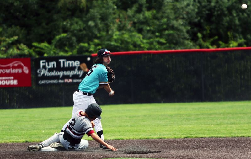 PMG PHOTO: DAN BROOD - Tualatin second baseman Joey Myers makes a throw to first base after forcing out Sherwood's Chase Highberger during Thursday's game at the Clackamas Diamond Classic.