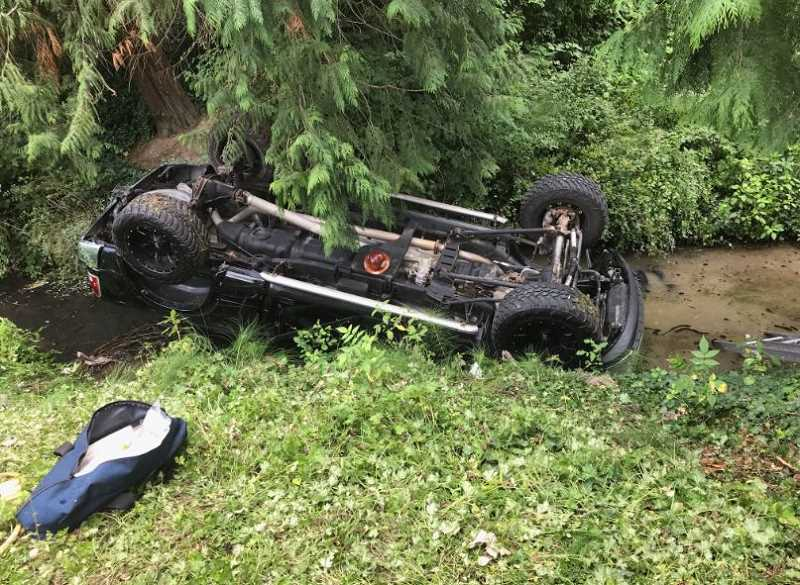 COURTESY OF WASHINGTON COUNTY SHERIFFS DEPARTMENT - Tualatin Valley Fire and Rescue firefighters were able to get the driver, 24-year-old Ryan Hamilton, out of the vehicle, which had flipped upside down into shallow water.