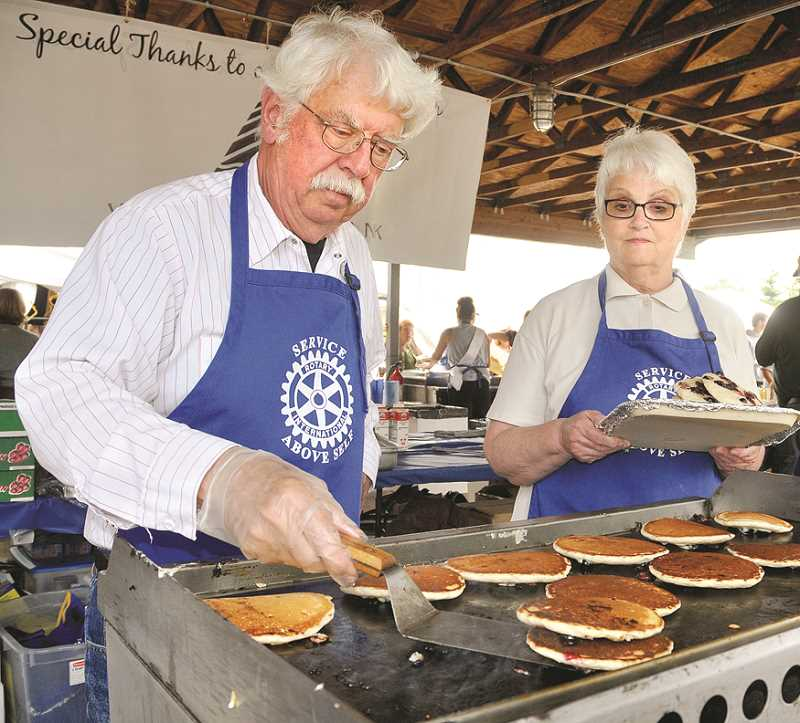 GRAPHIC FILE PHOTO - Newberg's Rotary clubs have been serving pancakes at the Old Fashioned Festival for decades.