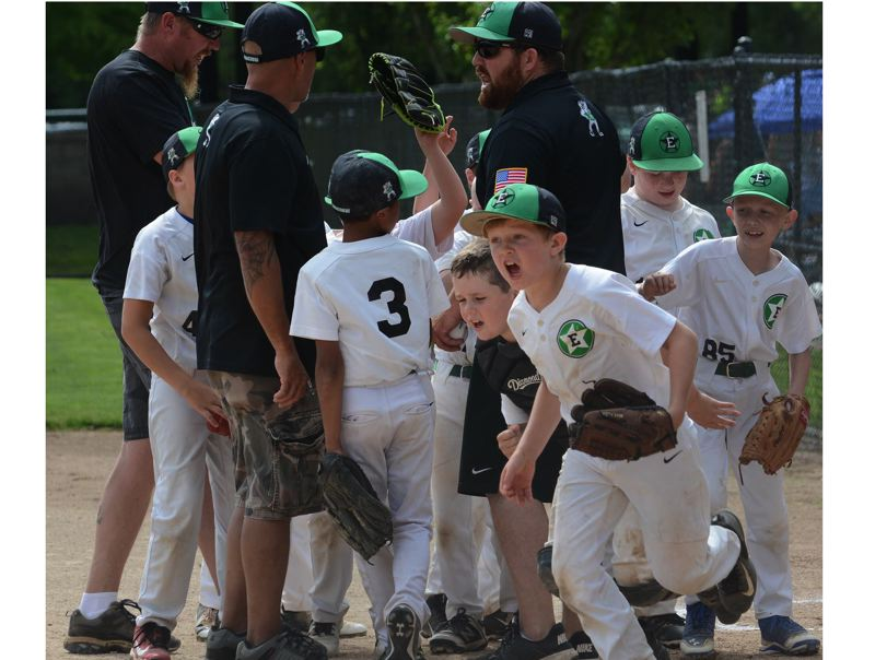 PMG PHOTO: DAVID BALL - Estacada heads for the handshake line at home plate after securing its 6-3 first-round win over Mill City on Friday at the Minors Nationals state tournament.