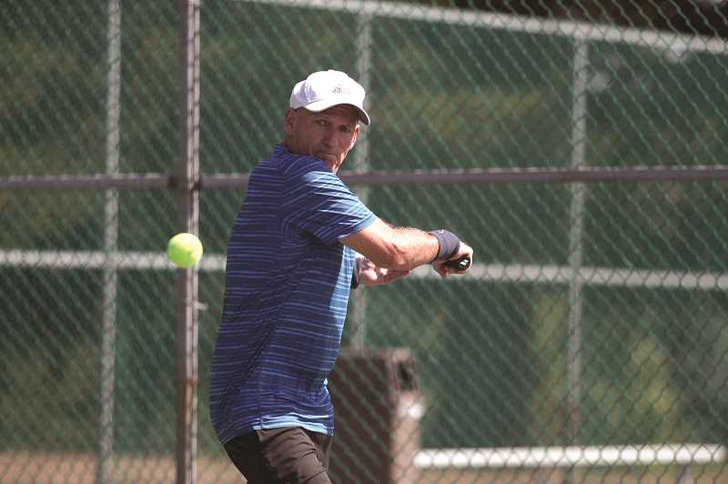 PMG PHOTO: PHIL HAWKINS - Woodburn High School boys tennis coach Tom Lonergan has won three national tournaments in his age bracket since the beginning of the year, putting him 15th overall among mens players 65 and older since Jan. 1.