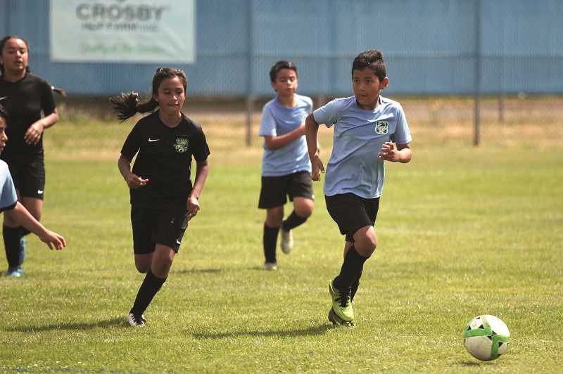 PMG PHOTO: PHIL HAWKINS - Athletes as young as U10 competed at the tournament, in smaller 7-on-7 games set up in the outfield of the Woodburn High School varsity baseball field.
