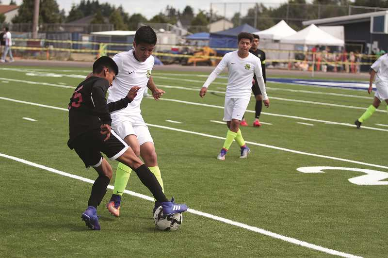 PMG PHOTO: PHIL HAWKINS - The Flavor de Futbol tournament provided the school district an opportunity to showcase its new synthetic turf field that was installed this spring.