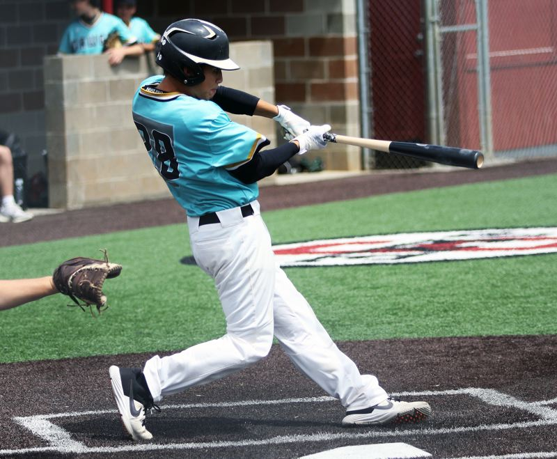 PMG PHOTO: DAN BROOD - Tualatin's Kevin Bergh takes a swing during action at last week's Clackamas Diamond Classic tournament. The Dawgs reached the tourney title game.