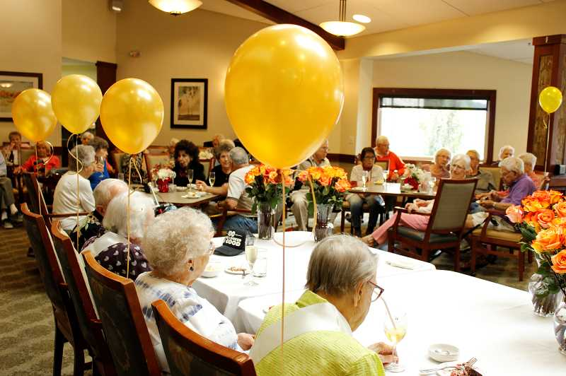 PMG PHOTO: AVA EUCKER - Balloons decorate chairs of those being celebrated for birthdays.