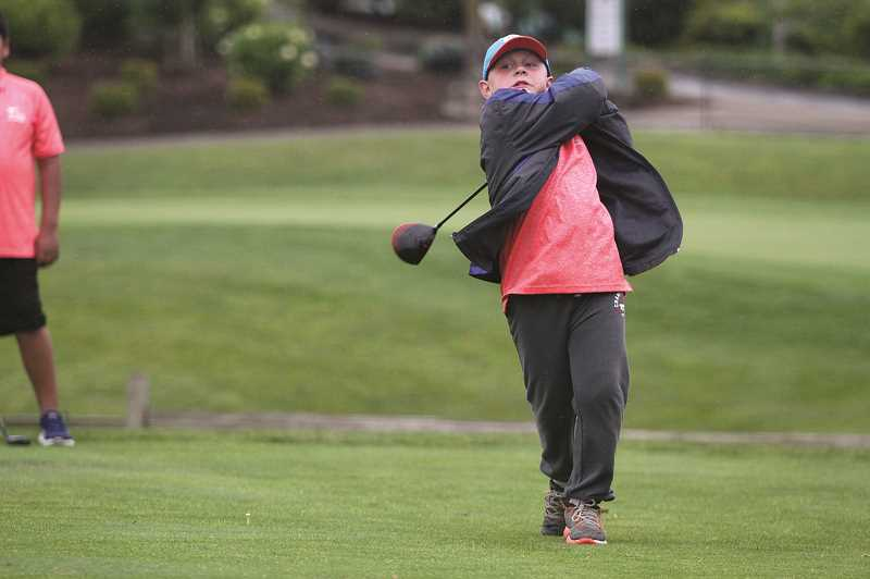 PMG PHOTO: PHIL HAWKINS - Young golfers at Woodburn's OGA summer golf program take part in a 10-week course that includes six weeks of games.