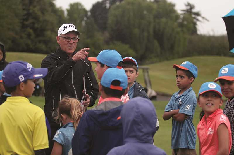 PMG PHOTO: PHIL HAWKINS - OGA Head Professional Mark Keating gathers kids to his side to prepare for a match, which consists of between six and nine shortened holes, depending on the level of the golfers.