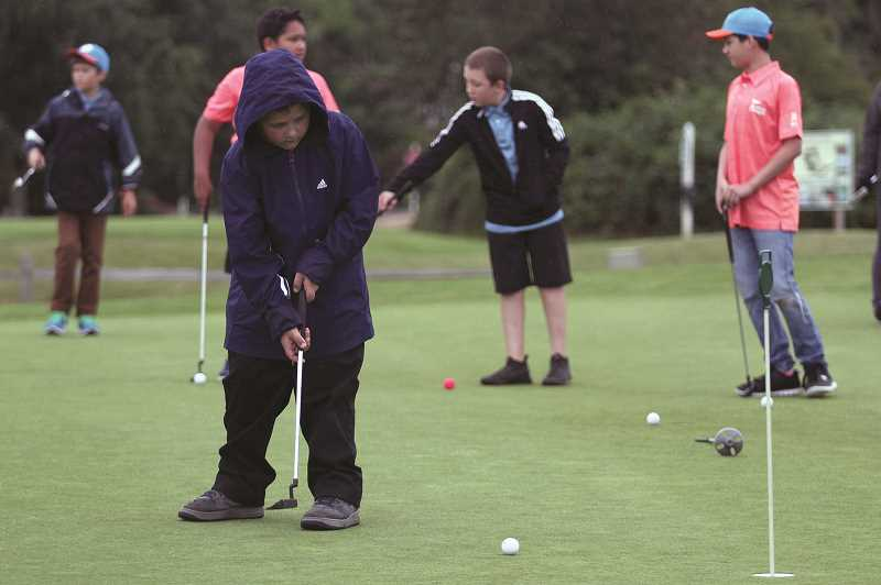 PMG PHOTO: PHIL HAWKINS - Many of the golfers take advantage of the PGA Reach scholarship, which pays for the programs $170 fee for Woodburn youth within the school districts summer lunch program.