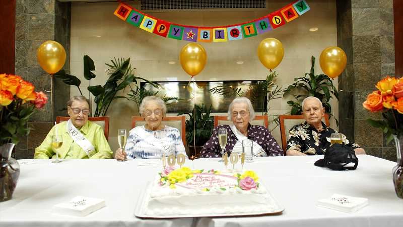 PMG PHOTO: AVA EUCKER - From left Trudy Young, Ferriel DeLap, Dallas Bersack and Grant Valentine are celebrated.