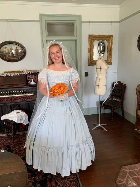 COURTESY PHOTO - Mollie Reel is a volunteer at Philip Foster Farm who is coordinating the wedding recreation at the upcoming garden party. She is also playing the role of the bride.