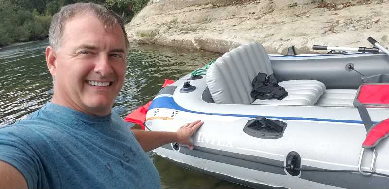 COURTESY PHOTO - Mike Pulham enjoys rafting with friends along the Clackamas River.