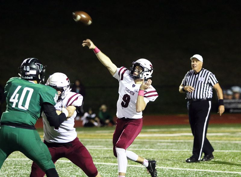 PMG FILE PHOTO: DAN BROOD - Tualatin's Kyle Dernedde (9) throws a pass against rival Tigard during a 2017 Three Rivers League football contest.