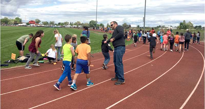 SUBMITTED PHOTO - Culver elementary students spent time gathering sponsors and worked hard running, walking and jogging laps at the Culver PTO's annual Jogathon to help raise money for the new playground.