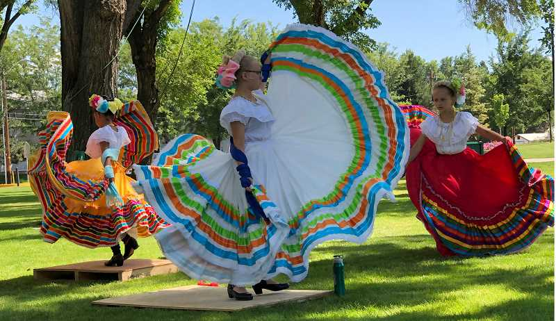 SUBMITTED PHOTO - StudioK Dancers, from left to right, Jahzel Vilal, 8, Samantha Isaac, 11, Tylie Isaac, 8, perform traditional Mexican dances during Key Club's Kids' Cultural Day at Saturday Market.