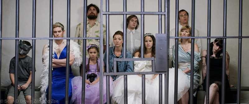 The whole bridal party ends up in jail in one of their lower moments in this scene from Zilla and Zoe showing this weekend, July 19 through 21 at the Clinton Street Theater in Portland.