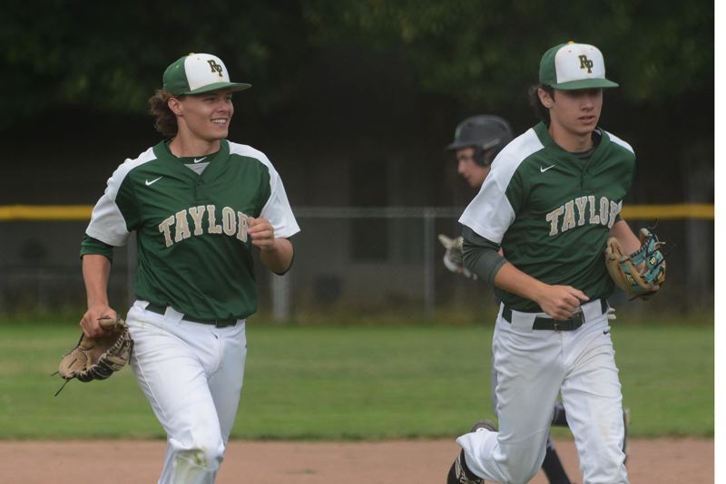 PMG PHOTO: DAVID BALL - Rex Putnam infielders Tanner Drog (left) and Vinny Salvione trot off the field after turning a double play to end the fourth inning of Tuesdays 7-4 win at Mt. Hood Select.