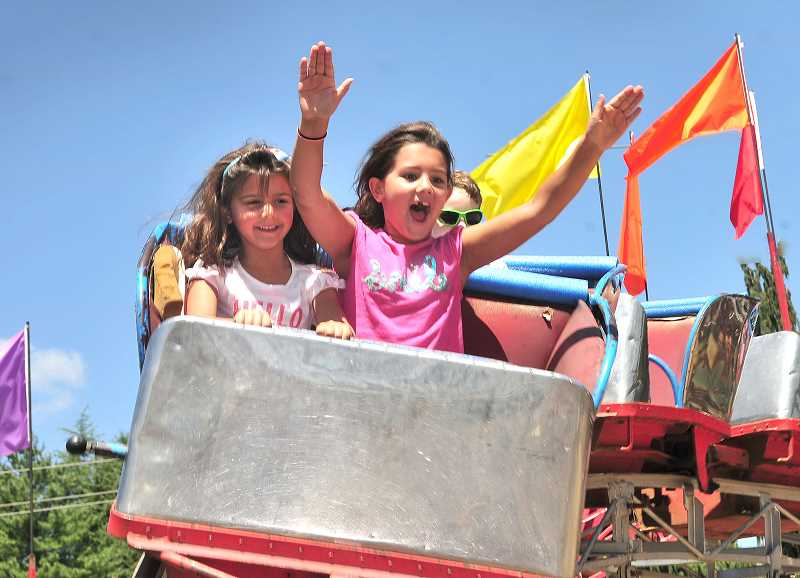 PGM FILE PHOTOS:  - The West Linn Old Time Fair is a summertime highlight in West Linn. The event includes a carnival, car show, music, foods and lots of fun.