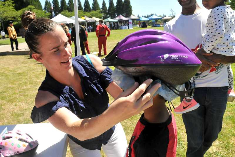 PMG FILE PHOTO - Legacy Health will be on hand with free bike helmets for kids and help with proper fitting, at the Wilsonville Wellness Fair.