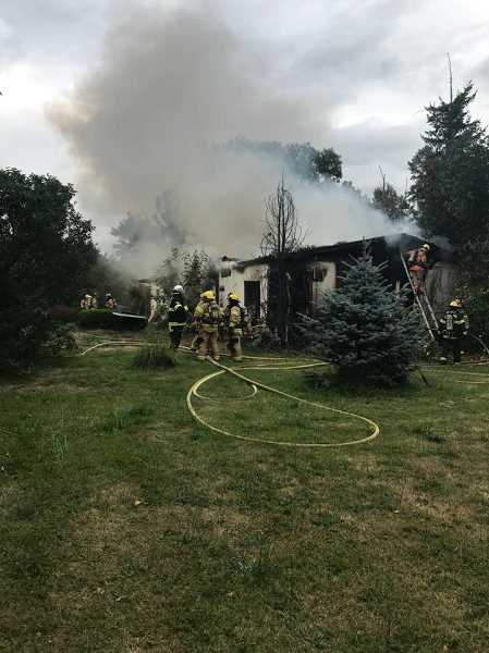 COURTESY PHOTO: MOLALLA FIRE - Fire crews tackle a fire at Macksburg Road, east of Highway 213 on Wednesday, July 17.
