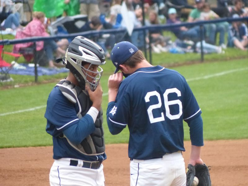 PMG PHOTO: KYLE GARCIA - Portland Pickles catcher Darius Perry (left) confers on the mound with starter Brad McVay as the home team beats Bellingham on Wednesday night at Walker Stadium.