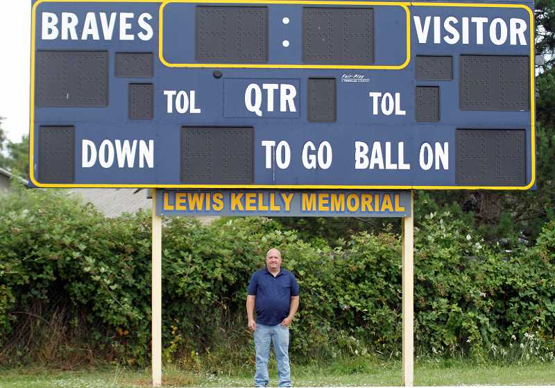 PMG PHOTO: WADE EVANSON - Banks' Trevor Beard stands beneath the scoreboard at Kelly Field at Banks High School. Beard has been broadcasting football games at Banks for four seasons.