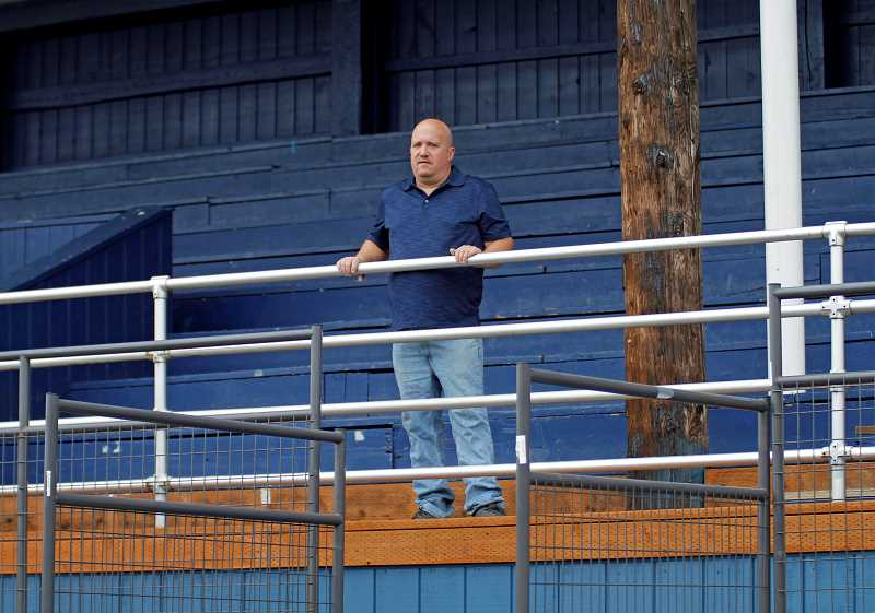 PMG PHOTO: WADE EVANSON - Banks' Trevor Beard poses for a photo in the grandstands at Kelly Field at Banks High School. Beard does play-by-play for Banks football from the bleachers during games.