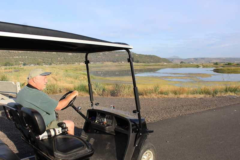 JASON CHANEY/CENTRAL OREGONIAN - Chuck Gates will take people on tours of the Crooked River Wetland Complex about twice a week. The tours are made possible by the city purchase of a golf cart for the volunteer group to use for the tours and wetland maintenance.