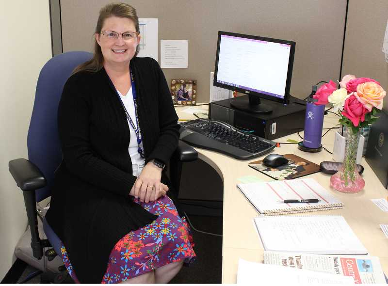 RAMONA MCALLISTER/CENTRAL OREGONIAN - Holly Scholz gets comfortable behind her desk with the Crook County School District. The former reporter is now the new CCSD Communication and Event Specialist.