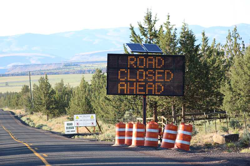 HOLLY M. GILL/MADRAS PIONEER - An electronic sign on Elk Drive, at the intersection with Belmont Lane, warns that the road is closed ahead. The paving project, which was delayed, is expected to be completed by July 26.