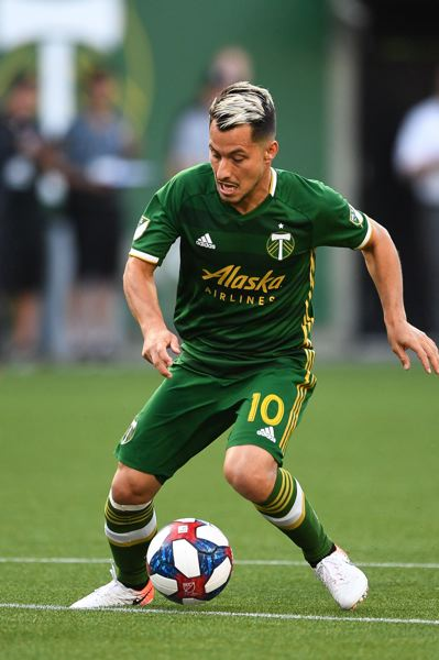 PMG PHOTO: CHRISTOPHER OERTELL - Sebastian Blanco makes a move with the ball for the Portland Timbers as they play Orlando City's Lions to a 1-1 draw Thursday night at Providence Park.