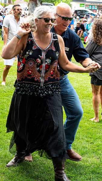 LON AUSTIN/CENTRAL OREGONIAN - Gabe and Diane Hendrix boogie to the sounds of Precious Byrd Wednesday night during the season opener of Picnic in the Park