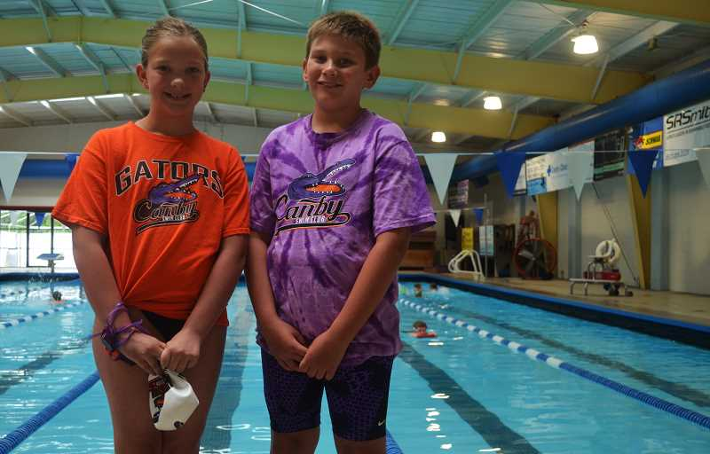 PMG PHOTO: DEREK WILEY - Canby Gators Quincy Taliaferro, left, and Samuel Goktas competed in the Oregon Swimming 10-and-under championships July 13-14 in Albany.