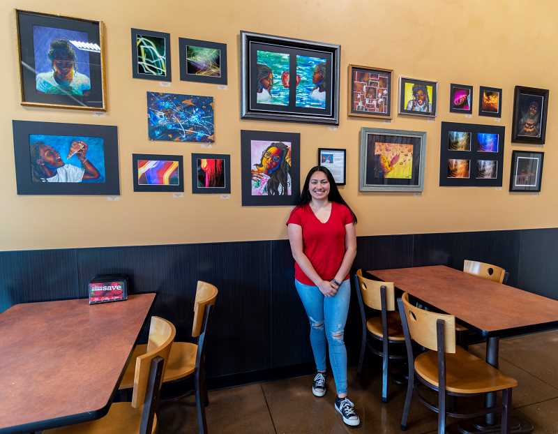 PMG PHOTO: CLARA HOWELL  - Alexis Leon-Guerrero has her artwork on display at the Fred Meyer Starbucks through the first week of August.