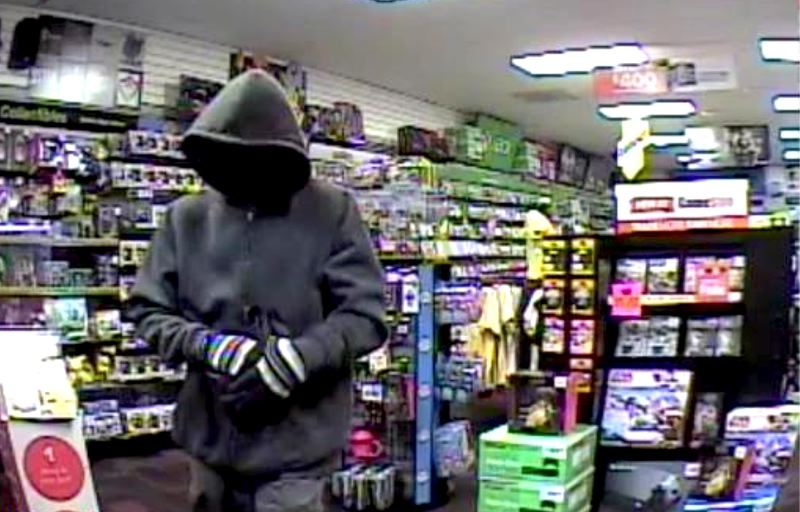 COURTESY PHOTO: MULTNOMAH COUNTY DA - A surveillance video shot shows one of the knifepoint robberies committed by Nigel and Stephanie Floyd. They were sentenced Friday, July 19, to long stretches in prison.