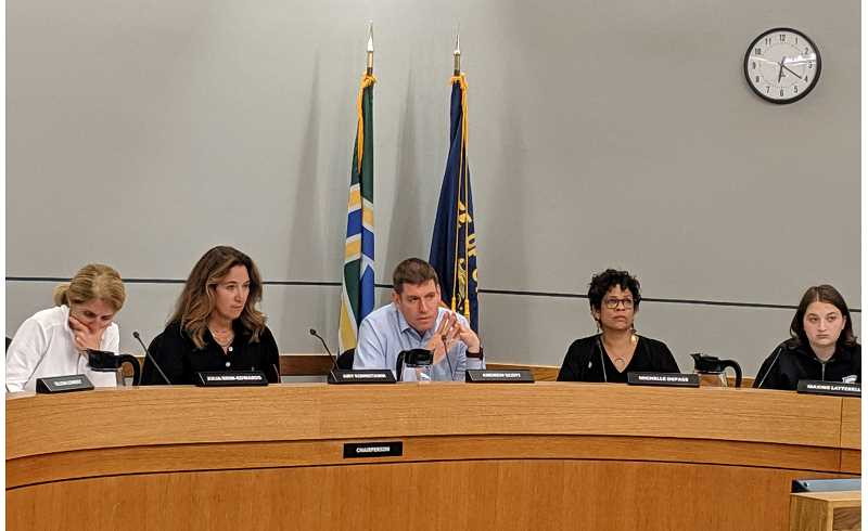 PMG PHOTO: COURTNEY VAUGHN - Portland Public Schools board members get input from staff about timelines for filing a renewal of the PPS local option levy. Pictured left to right: Julia Brim-Edwards, Amy Kohnstamm, Andrew Scott, Michelle DePass and student representative Maxine Latterell.