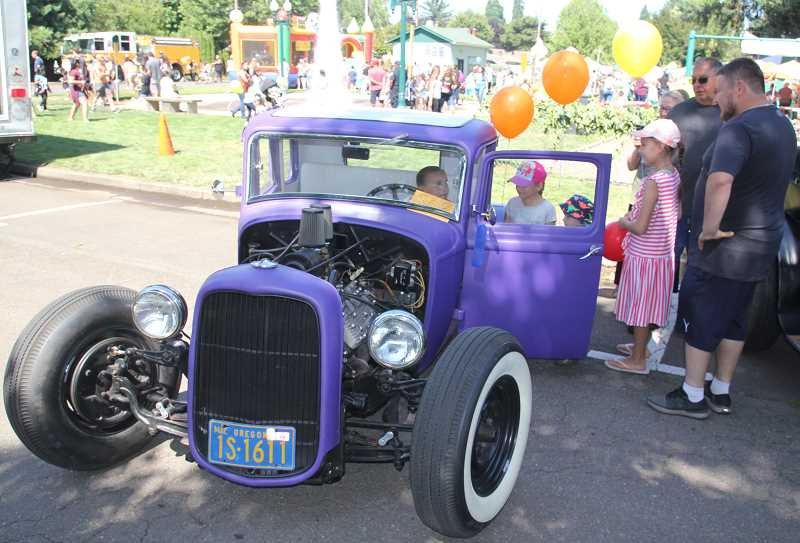 PMG PHOTO: JUSTIN MUCH - Checking out a classic cruiser during the 44th Annual Hubbard Hop Festival Saturday, July 20, 2019.