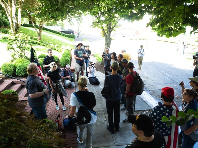 PMG PHOTO: KIT MACAVOY - Fewer than 20 people showed up for the Saturday morning, July 20, rally outside Mayor Ted Wheeler's home. The rally was organized by Portland Liberation, an offshoot of the right-wing Patriot Prayer group.